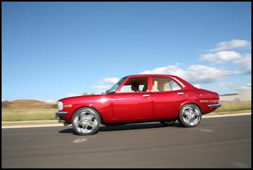 Old School Mazda RX3 rotary sedan with full custom leather trim, sydney style, big rims, candy apple paint, turbo performance vehicle. Mazda car australia