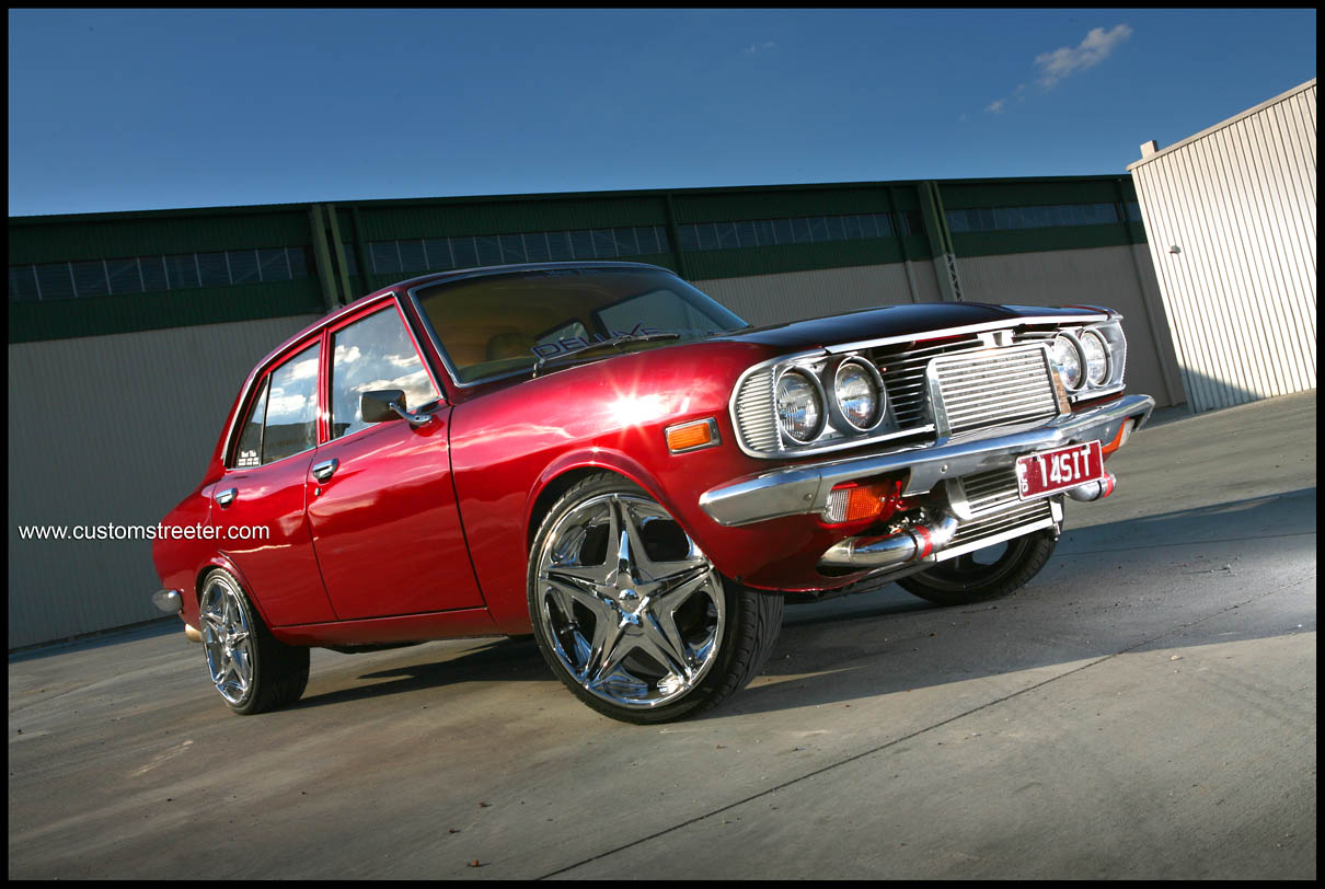 Featured on www.customstreeter.com Candy apple red Mazda RX2 Rotary with the most beautiful custom leather trim