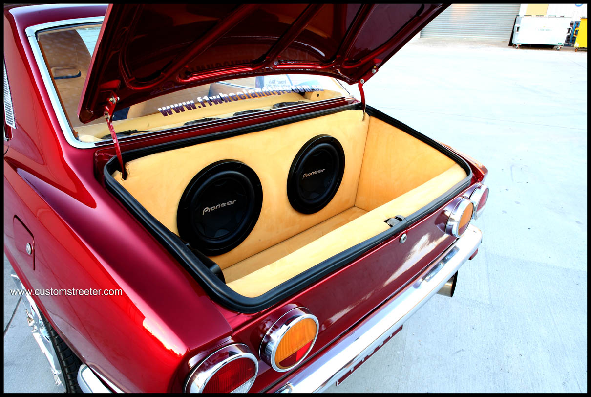Featured on www.customstreeter.com Candy apple red Mazda RX2 Rotary with the most beautiful custom leather trim, Old School Mazda rotor with new school twist, featured in Hot 4s Magazine.